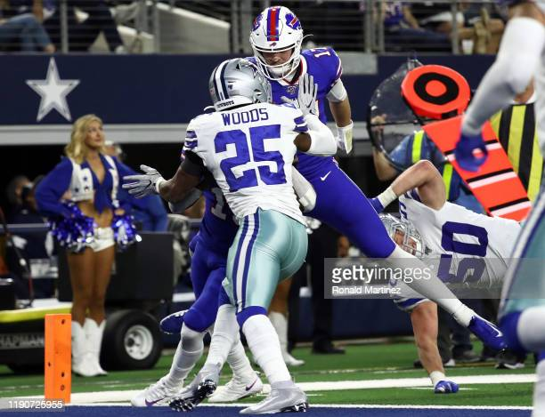 Josh Allen of the Buffalo Bills runs for a touchdown against Xavier Woods of the Dallas Cowboys in the second half at AT&T Stadium on November 28,...