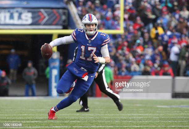Josh Allen of the Buffalo Bills runs with the ball for a big gain in the third quarter during NFL game action against the Miami Dolphins at New Era...