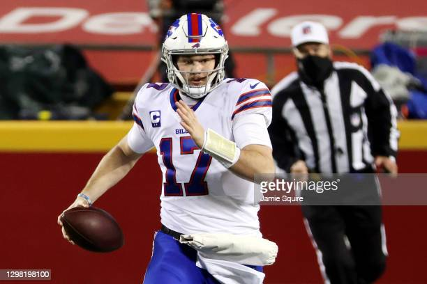 Josh Allen of the Buffalo Bills runs with the ball in the first quarter against the Kansas City Chiefs during the AFC Championship game at Arrowhead...