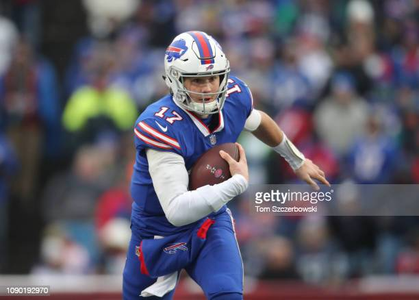 Josh Allen of the Buffalo Bills runs with the ball in the second quarter during NFL game action against the Miami Dolphins at New Era Field on...