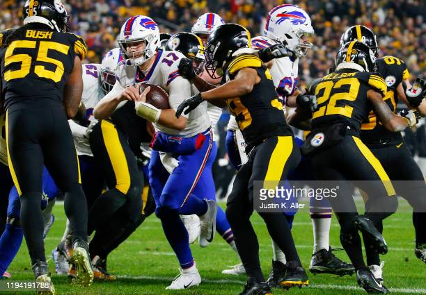 Josh Allen of the Buffalo Bills rushes for a 1-yard touchdown during the second quarter against the Pittsburgh Steelers in the game at Heinz Field on...