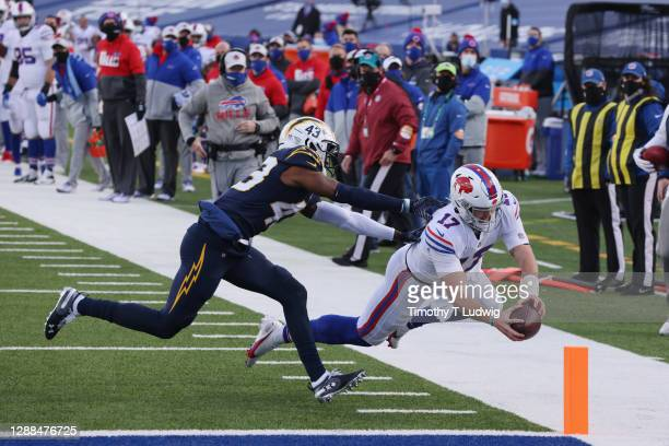 Josh Allen of the Buffalo Bills scores a touchdown during the third quarter against the Los Angeles Chargers at Bills Stadium on November 29, 2020 in...