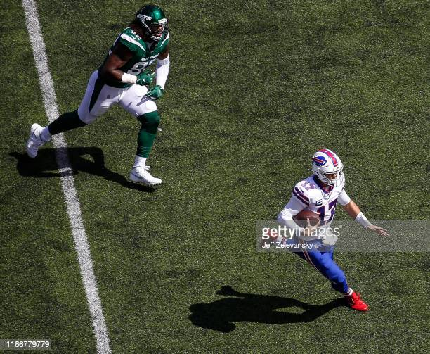 Josh Allen of the Buffalo Bills scrambles in front of Leonard Williams of the New York Jets during their game at MetLife Stadium on September 8 2019...