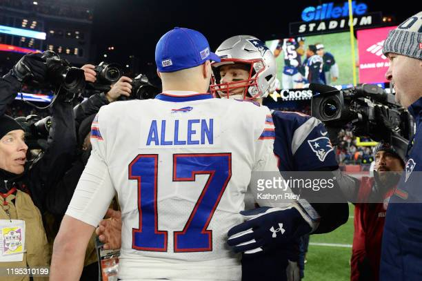 Josh Allen of the Buffalo Bills shakes hands with Tom Brady of the New England Patriots after the Patriots defeated the Bills 2417 in the game at...