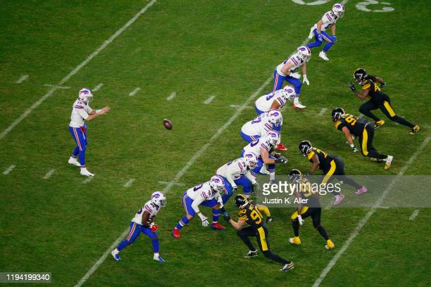 Josh Allen of the Buffalo Bills takes a snap during the second half against the Pittsburgh Steelers in the game at Heinz Field on December 15 2019 in...