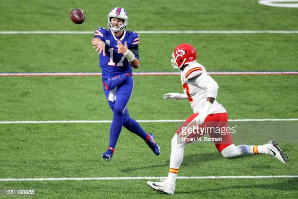 Josh Allen of the Buffalo Bills throws a touchdown pass to Stefon Diggs , as Alex Okafor of the Kansas City Chiefs defends during the first half at...