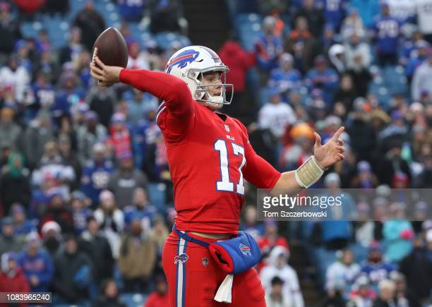Josh Allen of the Buffalo Bills throws and completes a pass in the fourth quarter during NFL game against the Detroit Lions at New Era Field on...