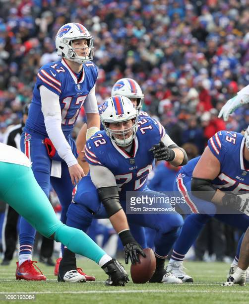 Josh Allen of the Buffalo Bills waits for the snap as Ryan Groy calls out instructions in the third quarter during NFL game action against the Miami...