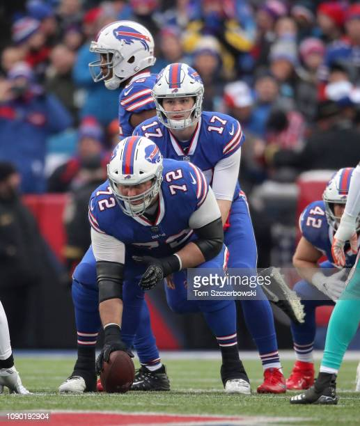 Josh Allen of the Buffalo Bills waits for the snap from Ryan Groy in the first quarter during NFL game action against the Miami Dolphins at New Era...