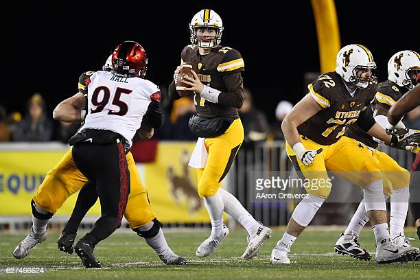 Josh Allen of the Wyoming Cowboys drops back against the San Diego State Aztecs during the first quarter of play on Saturday December 3 2016 The...