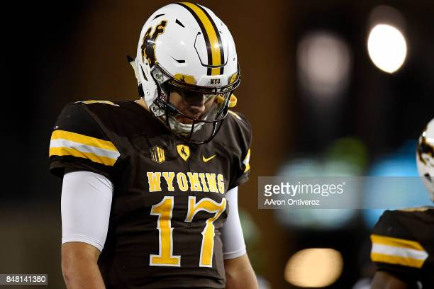 Josh Allen of the Wyoming Cowboys hangs his head after failing to convert a third down against the Oregon Ducks during the second half of the Ducks'...