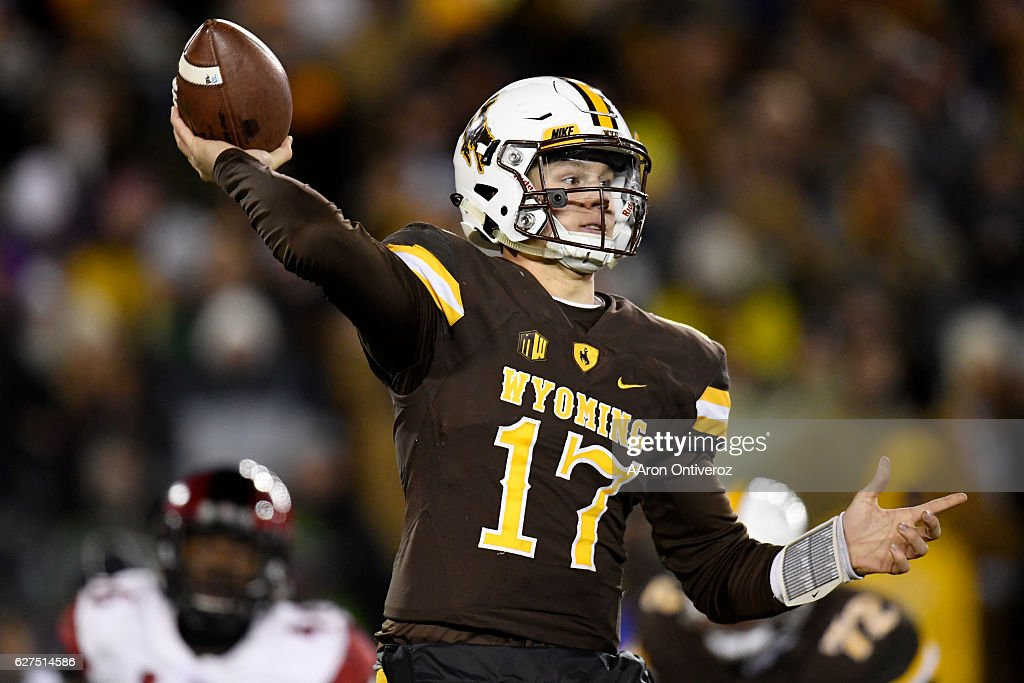 Josh Allen (17) of the Wyoming Cowboys passes against the San Diego State Aztecs during the second half of San Diego State's 27-24 win on Saturday, December 3, 2016. The Wyoming Cowboys hosted the San Diego State Aztecs in the Mountain West championship game.