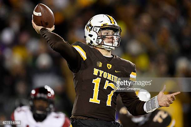 Josh Allen of the Wyoming Cowboys passes against the San Diego State Aztecs during the second half of San Diego State's 2724 win on Saturday December...