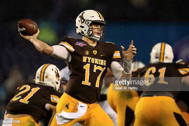Josh Allen of the Wyoming Cowboys passes the ball during the first half of the Poinsettia Bowl at Qualcomm Stadium on December 21 2016 in San Diego...