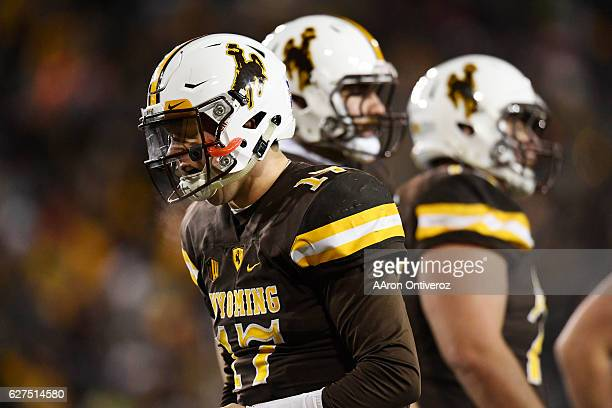 Josh Allen of the Wyoming Cowboys reacts to being sacked against the San Diego State Aztecs during the second half of San Diego State's 2724 win on...
