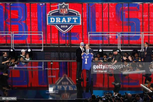Josh Allen of Wyoming poses with NFL Commissioner Roger Goodell after being picked overall by the Buffalo Bills during the first round of the 2018...