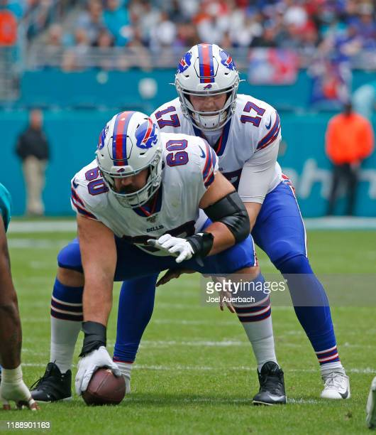 Josh Allen prepares to take the snap from Mitch Morse of the Buffalo Bills against the Miami Dolphins during an NFL game on November 17, 2019 at Hard...
