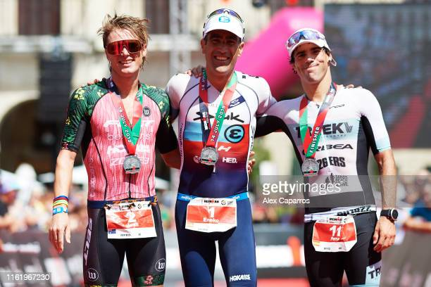 Josh Amberger of Australia in 2nd position Eneko Llanos of Spain in 1st position and Peru Alfaro of Spain in 3rd position celebrate their results...