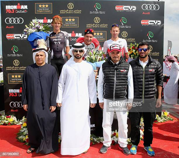 Josh Amberger of Australia Jan Frodeno of Germany Bart Aernouts of Belgium pose with Mattar Al Tayer Chairman of the Board and Executive Director of...