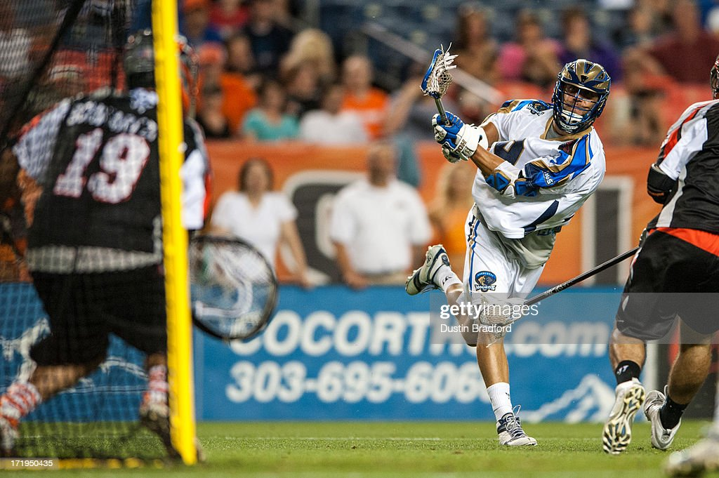 Josh Amidon #9 of the Charlotte Hounds shoots against the Denver Outlaws during a Major League Lacrosse game at Sports Authority Field at Mile High on June 29, 2013 in Denver, Colorado. The Outlaws beat the Hounds 17-11 and improved to 9-0 on the season.