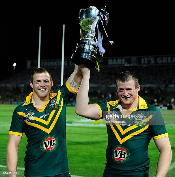 Josh and Brett Morris hold up the trophy after winning the International Test match between the Australian Kangaroos and the New Zealand Kiwis at...