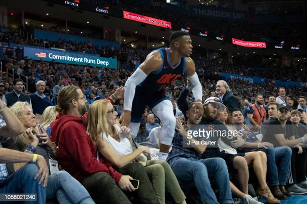 Josh and Jennifer Welch from the tv show, Sweet Home Oklahoma, watch as as Russell Westbrook of the Oklahoma City Thunder climbs over fans during the...