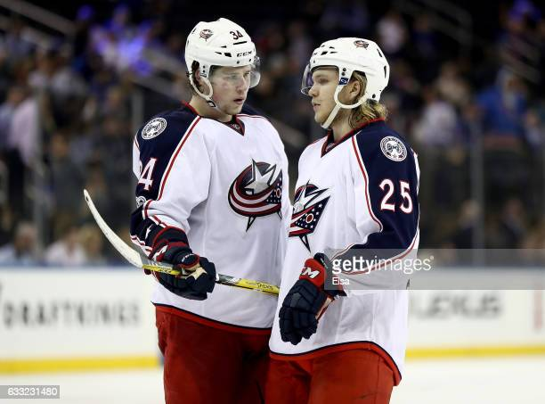 Josh Anderson and William Karlsson of the Columbus Blue Jackets talk before a face off in the third period against the New York Rangers on January 31...