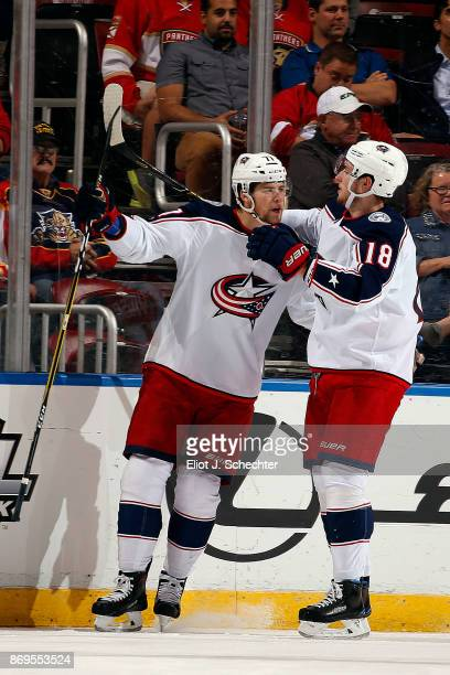 Josh Anderson celebrates his goal with teammate PierreLuc Dubois of the Columbus Blue Jackets during the first period against the Florida Panthers at...