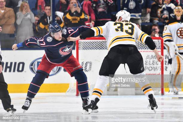 Josh Anderson of the Columbus Blue Jackets and Zdeno Chara of the Boston Bruins fight during the second period of a game on October 30 2017 at...