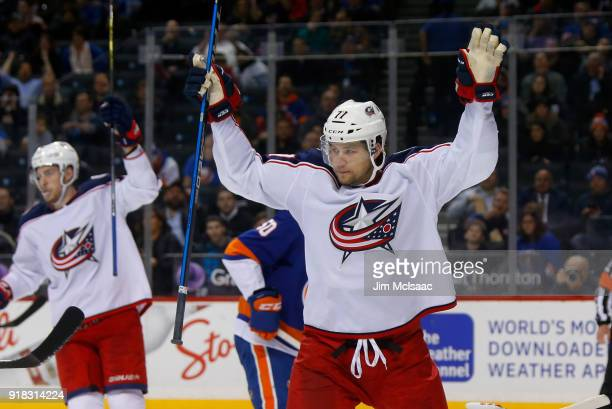 Josh Anderson of the Columbus Blue Jackets celebrates a goal by teammate Oliver Bjorkstrand against the New York Islanders during the second period...