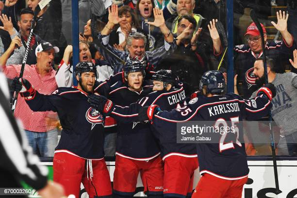 Josh Anderson of the Columbus Blue Jackets celebrates his first period goal with Kyle Quincey Matt Calvert and William Karlsson of the Columbus Blue...