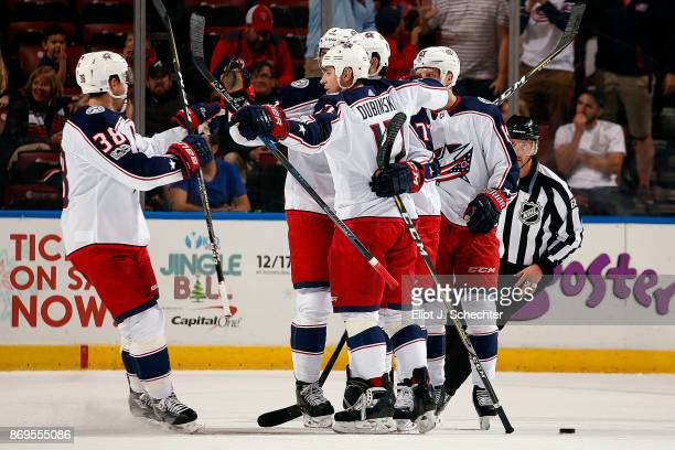 Josh Anderson of the Columbus Blue Jackets celebrates his second goal of the game with teammates during the first period against the Florida Panthers...
