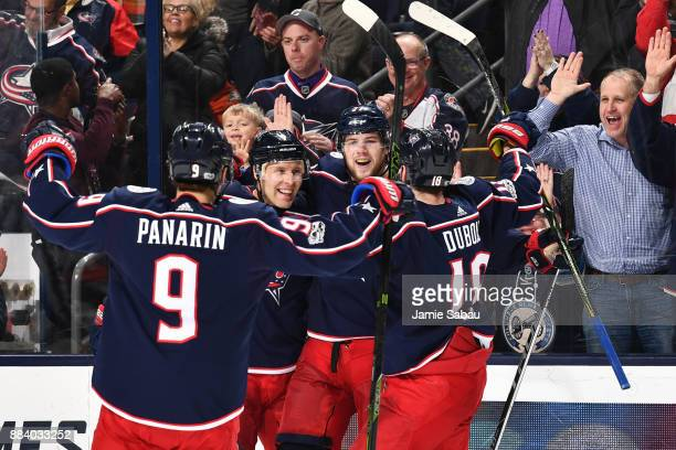 Josh Anderson of the Columbus Blue Jackets celebrates his third period goal with his teammates during a game against the Anaheim Ducks on December 1...