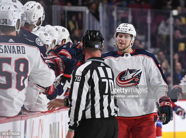 Josh Anderson of the Columbus Blue Jackets celebrates with the bench after scoring a goal against the Montreal Canadiens in the NHL game at the Bell...