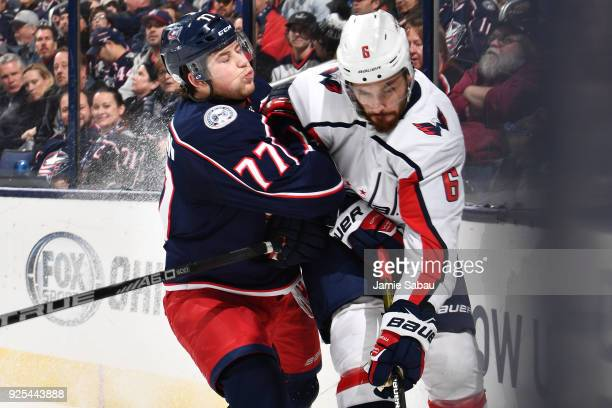 Josh Anderson of the Columbus Blue Jackets checks Michal Kempny of the Washington Capitals on February 26 2018 at Nationwide Arena in Columbus Ohio