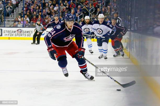 Josh Anderson of the Columbus Blue Jackets controls the puck during the game against the Winnipeg Jets on April 6 2017 at Nationwide Arena in...