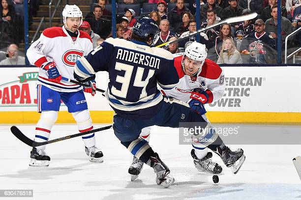 Josh Anderson of the Columbus Blue Jackets is checked off the puck by Shea Weber of the Montreal Canadiens during the first period of a game on...