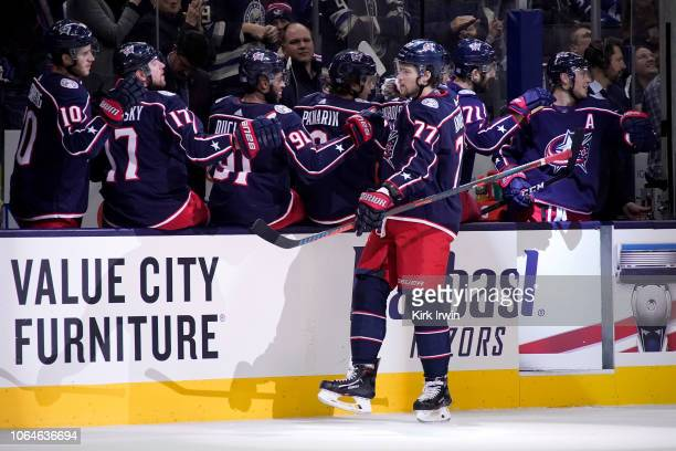 Josh Anderson of the Columbus Blue Jackets is congratulated by his teammates after scoring a goal during the first period of the game against the...