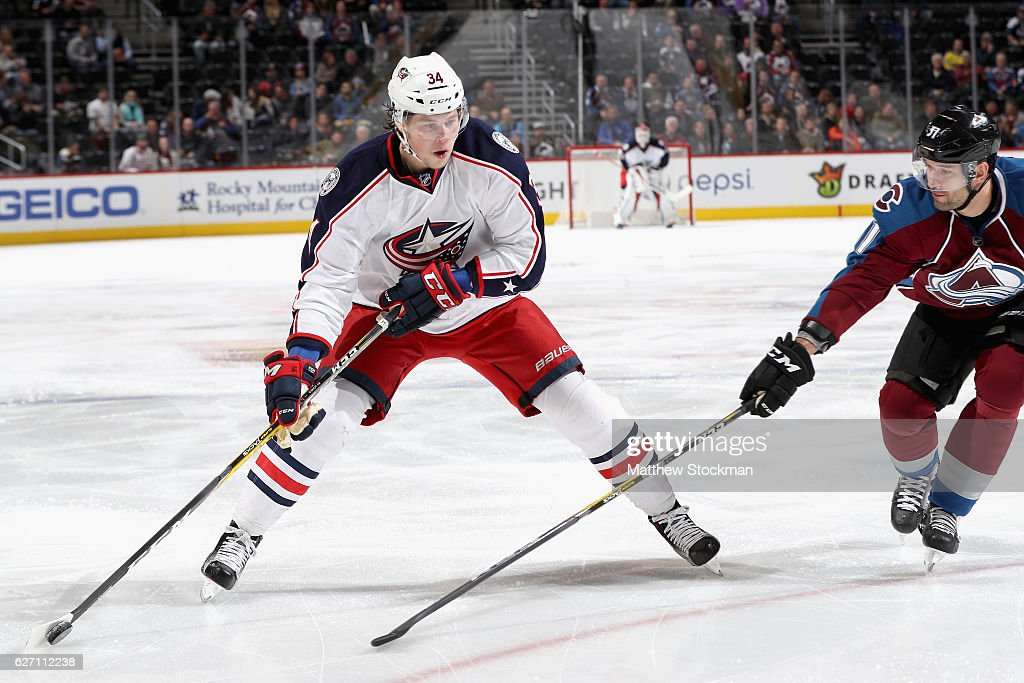 Josh Anderson #34 of the Columbus Blue Jackets looks for a shot past Fedor Tyutin #51 of the Colorado Avalanche at the Pepsi Center on December 1, 2016 in Denver, Colorado.