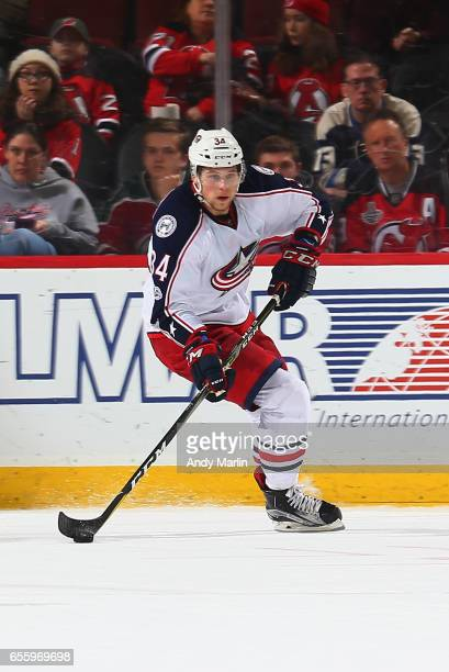 Josh Anderson of the Columbus Blue Jackets plays the puck against the New Jersey Devils during the game at Prudential Center on March 19 2017 in...
