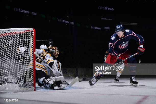 Josh Anderson of the Columbus Blue Jackets scores on goaltender Tuukka Rask of the Boston Bruins during the first period of a game on March 12 2019...