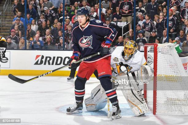 Josh Anderson of the Columbus Blue Jackets skates in front of goaltender MarcAndre Fleury of the Pittsburgh Penguins in Game Four of the Eastern...