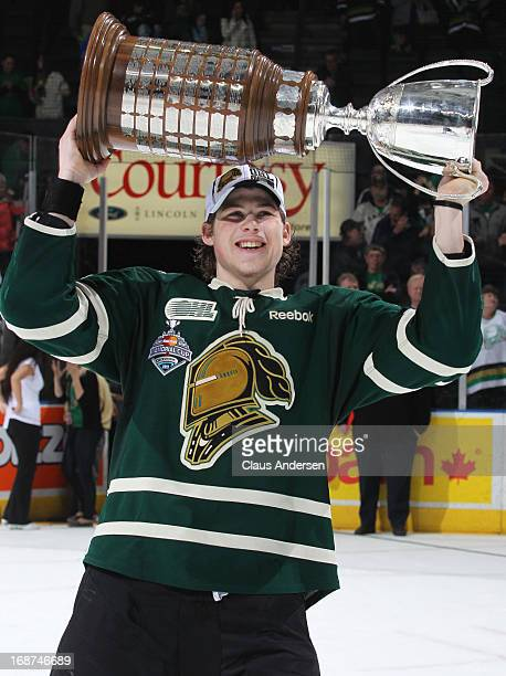 Josh Anderson of the London Knights hoists the Robertson Cup after defeating the Barrie Colts in Game Seven in the 2013 OHL Championship Final on May...