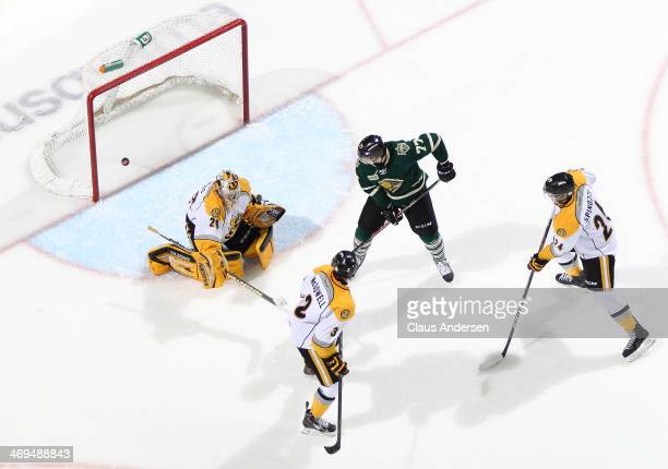 Josh Anderson of the London Knights tips a shot by Taylor Dupuis of the Sarnia Sting during an OHL game at the Budweiser Gardens on February 14 2014...
