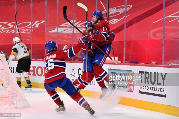 Josh Anderson of the Montreal Canadiens is congratulated by Paul Byron and Jesperi Kotkaniemi after scoring the game-winning goal against the Vegas...
