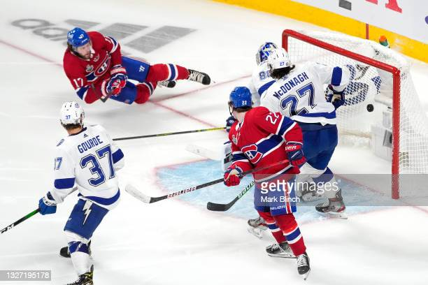 Josh Anderson of the Montreal Canadiens scores the game-winning goal past Andrei Vasilevskiy of the Tampa Bay Lightning to give his team the 3-2 win...