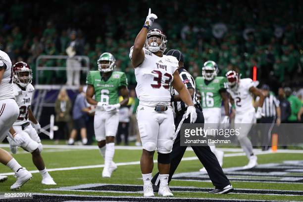Josh Anderson of the Troy Trojans celebrates a touchdown during the first half of the RL Carriers New Orleans Bowl against the North Texas Mean Green...