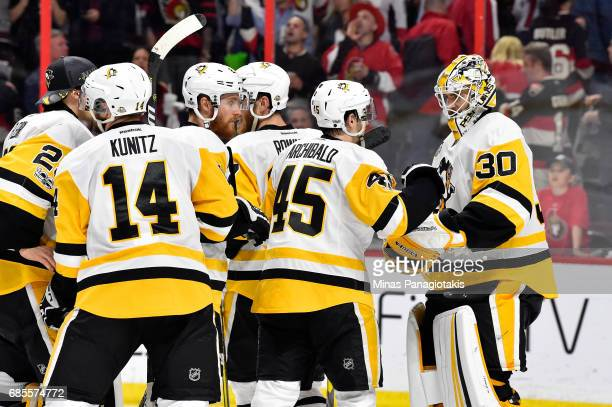 Josh Archibald and Matt Murray of the Pittsburgh Penguins celebrate after defeating the Ottawa Senators with a score of 3 to 2 in Game Four of the...