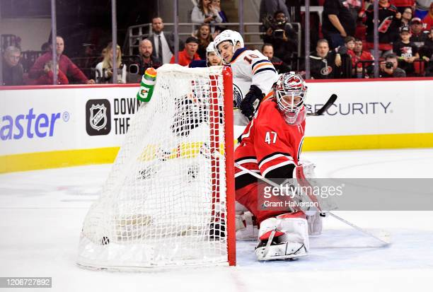 Josh Archibald of the Edmonton Oilers scores the gamewinning goal against James Reimer of the Carolina Hurricanes in overtime of their game at PNC...