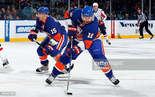 Josh Bailey and Jeff Tambellini of the New York Islanders skate against the Washington Capitals on October 24 2009 at Nassau Coliseum in Uniondale...